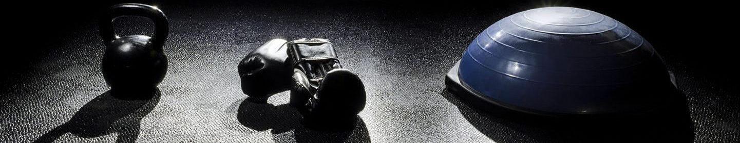 Personal training kettlebell boxing gloves Bosu ball on floor